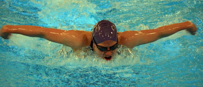 by: TIMES PHOTO: MATT SINGLEDECKER - Sunset girls swimmer Nina Stitt won two events for the Apollos against Aloha, including the 100 butterfly.
