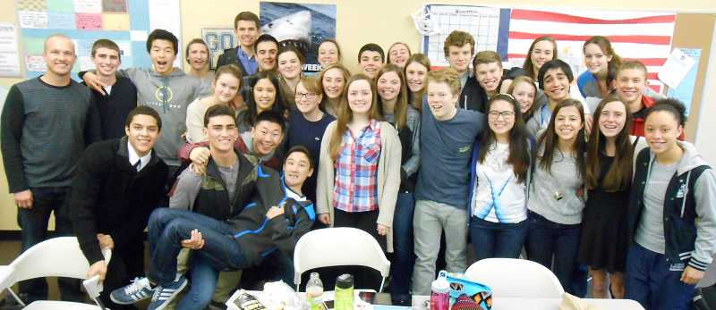 by: REVIEW PHOTO: JILLIAN DALEY - Lake Oswego High School leadership students banded together to organize a food drive.