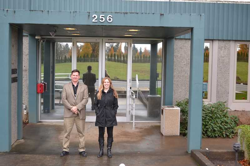 by: SUBMITTED PHOTO - Lt. Graham Phalen of the Clackamas County Sheriff's Office and Melissa Erlbaum, executive director of Clackamas Womens Services, are proud and happy about the new A Safe Place Family Justice Center, which opened last month in Oregon City.