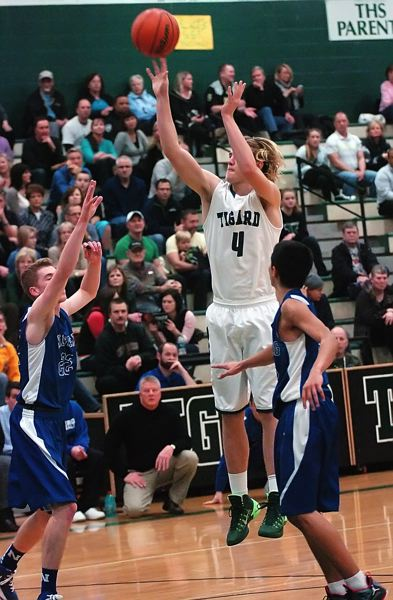 by: DAN BROOD - JETT JUMPER -- Tigard senior Jett Even (4) connects on a jump shot during the Tigers' win over Newberg.