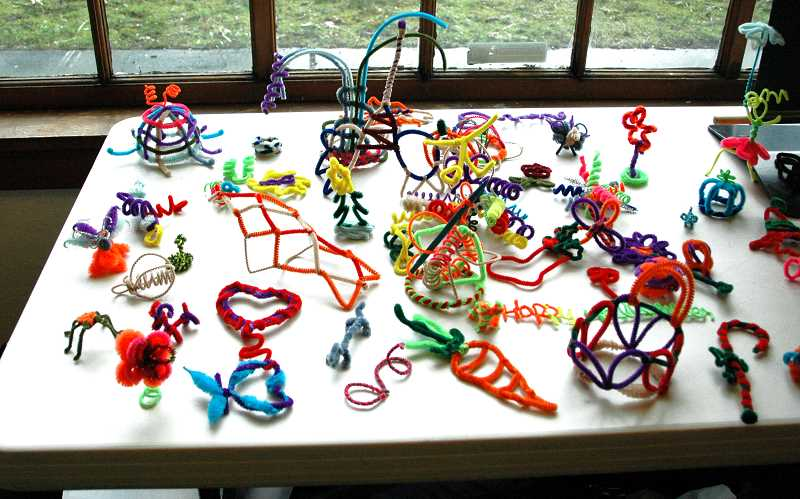 by: ISABEL GAUTSCHI - There were pipe cleaners on the tables during every work session held for the second group of Ford Institute leaders of Estacada. Their pipe-cleaner creatures were on display during their project unveiling.