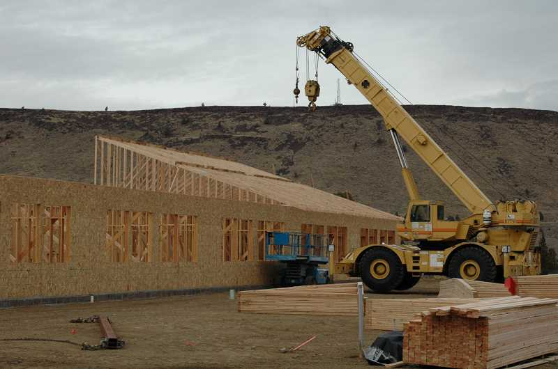 by: SUSAN MATHENY - Walls go up on the Warm Springs K-8 Academy in November.