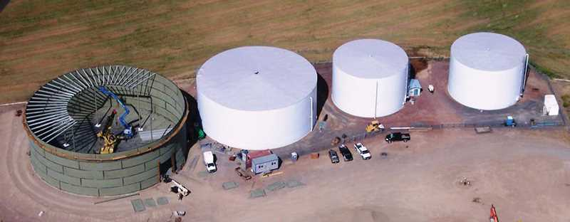 by: GARY DINKEL - The new 4 million gallon tank is shown during construction in this aerial view. The main tanks are located southwest of Culver.