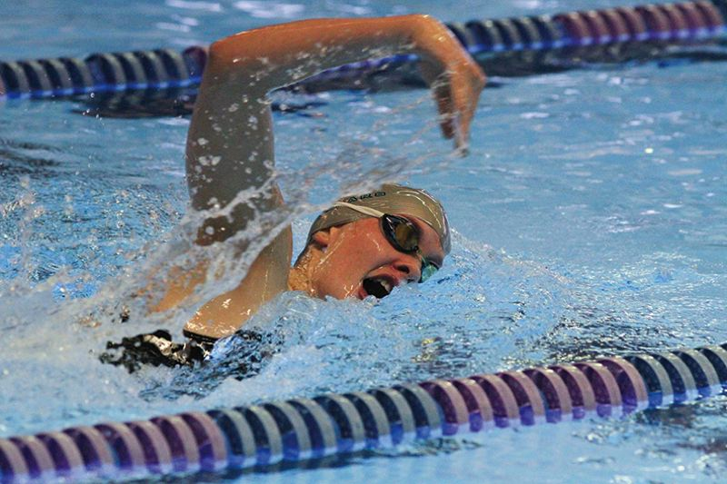 by: HILLSBORO TRIBUNE PHOTO: AMANDA MILES - Century junior Ellie Thornbrue swims to victory in the girls 500-yard freestyle at Tuesday's Pacific Conference swim meet that featured all three Class 6A Hillsboro-area schools.