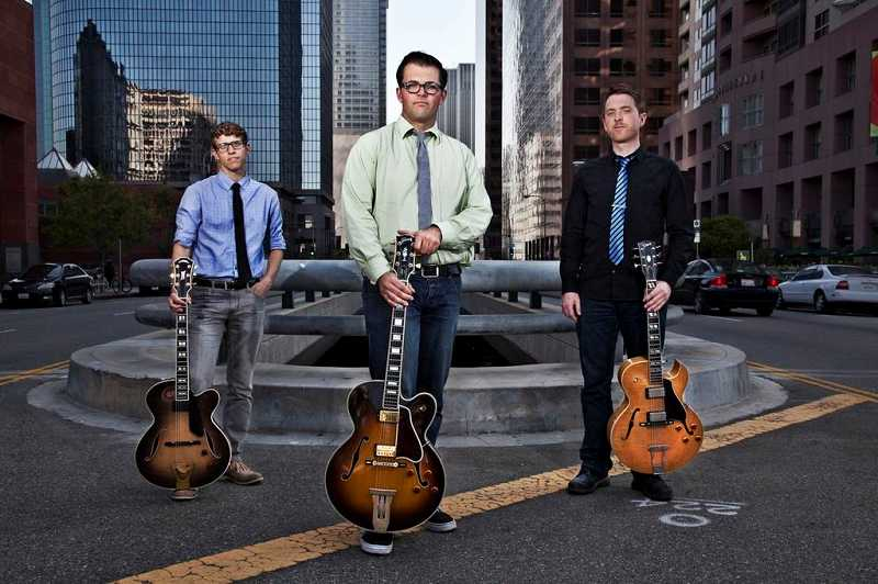 by: SUBMITTED PHOTO - New West Guitar Group, a Los Angeles-based band, will perform a benefit concert at Tigard High School on Friday to raise money for the schools guitar program.