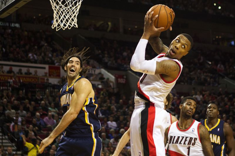 by: TRIBUNE PHOTO: JAIME VALDEZ - Second-year Trail Blazers point guard Damian Lillard, pulling down a rebound against Indiana, is the best clutch player in the NBA this season, according to statistics.