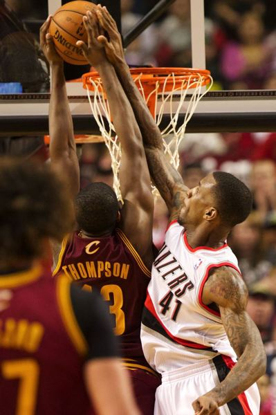 Backup forward Thomas Robinson blocks a shot by Cavaliers forward Tristan Thompson in the second half.