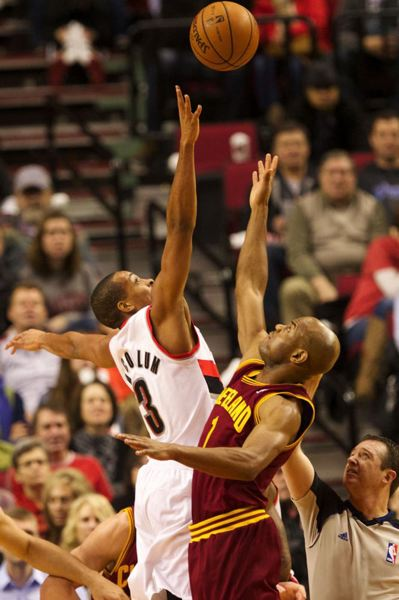 Rookie Blazers guard CJ McCollum (left) goes for a jump ball against Cleveland's Jarrett Jack.