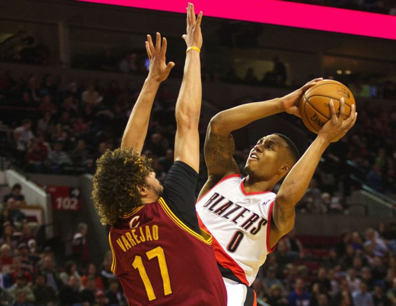 Damian Lillard leans back for a shot over Cleveland center Anderson Varejao.