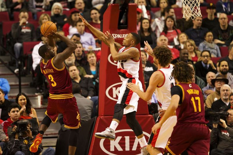 Cleveland guard Dion Waiters shoots over Damian Lillard.