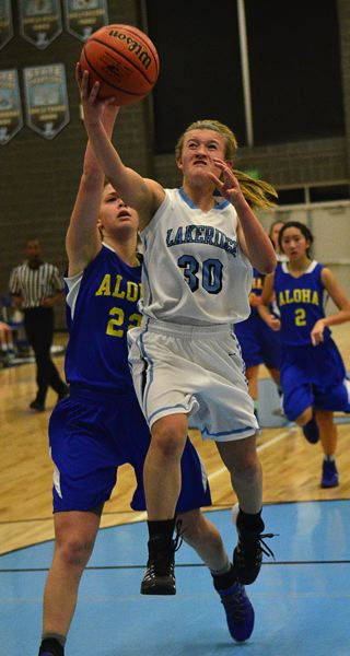 by: VERN UYETAKE - Lakeridge's Natalie Bristol scoops to the hoop in the Pacers' game last week against Aloha.