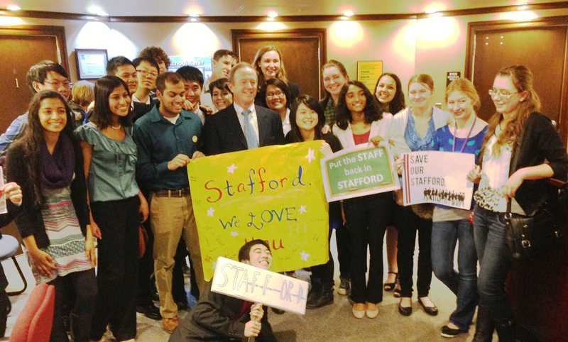 by: SUBMITTED PHOTO - Westview High School students and alumni surround Bert Stafford after addressing the Beaverton School Board Monday night to plead for an exception that would allow him to return to the classroom.