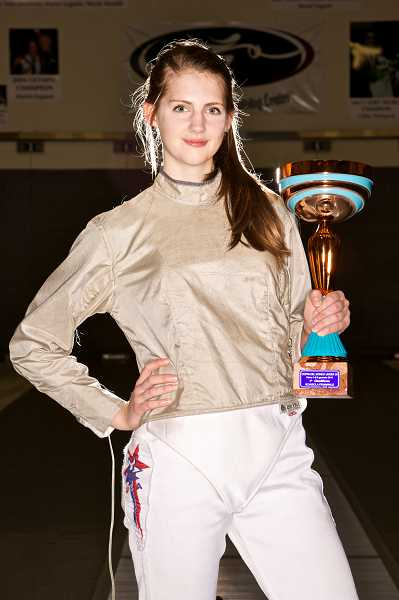 by: PAMPLIN MEDIA GROUP: JAIME VALDEZ - Raleigh Hills resident Sage Palmedo poses with the World Cup shes accumulated in her still-blossoming fencing career.