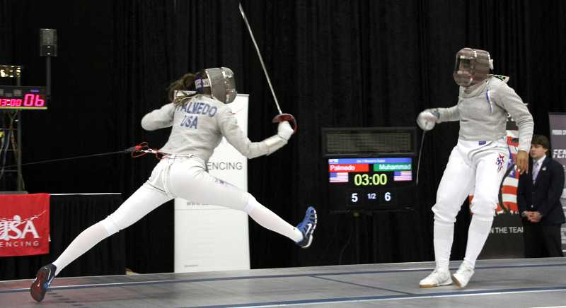 by: SUBMITTED PHOTO - Sage Palmedo displays her rapidly evolving fencing skills in one of her recent competitions.