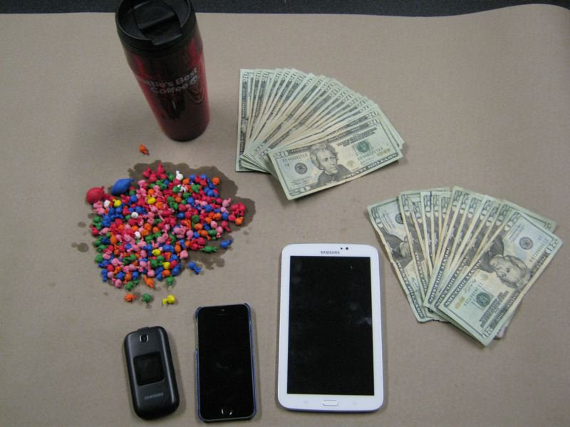 by: PORTLAND POLICE BUREAU - Four ounces of heroin and cocaine were seized in addition to $720 in cash and the other items shown here.