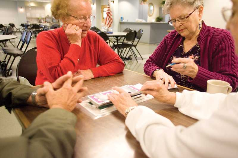 by: KEVIN SPERL - Roland Thompson, left, Joyce Jollo, Neva McPherson and Jean Birkby play bridge at the Soroptimist Senior Center last week.
