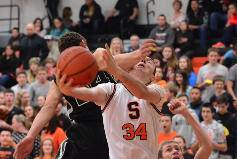 by: JOHN WILLIAM HOWARD - Junior Chase Johnson is fouled on his way to the hoop during the second half of Fridays' win over Estacada. Johnson led the Indians with 19 points in the victory, which gives Scappoose a huge momentum boost heading into league play.