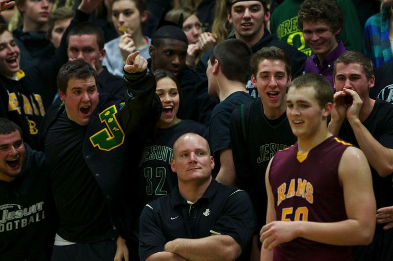 Jesuit Crusaders fans heckle Central Catholic's Blake Brandel (right) in the second half.