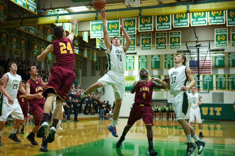 Jesuit wing Collin Landry shoots between Central Catholic Rams Bern College (left) and LaMar Winston during Friday's first half.