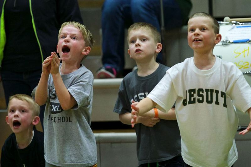 (From left) Mathew Kienow, age 6, Dylan Ruchaber 7, Daniel Kienow 9, and Caleb Ruchaber, 9, try to distract a Central Catholic player at the free-throw line.