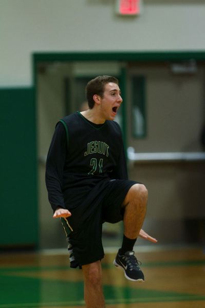 Crusaders senior Eric Leonard celebrates his halfcourt basket during a halftime contest at Jesuit High.