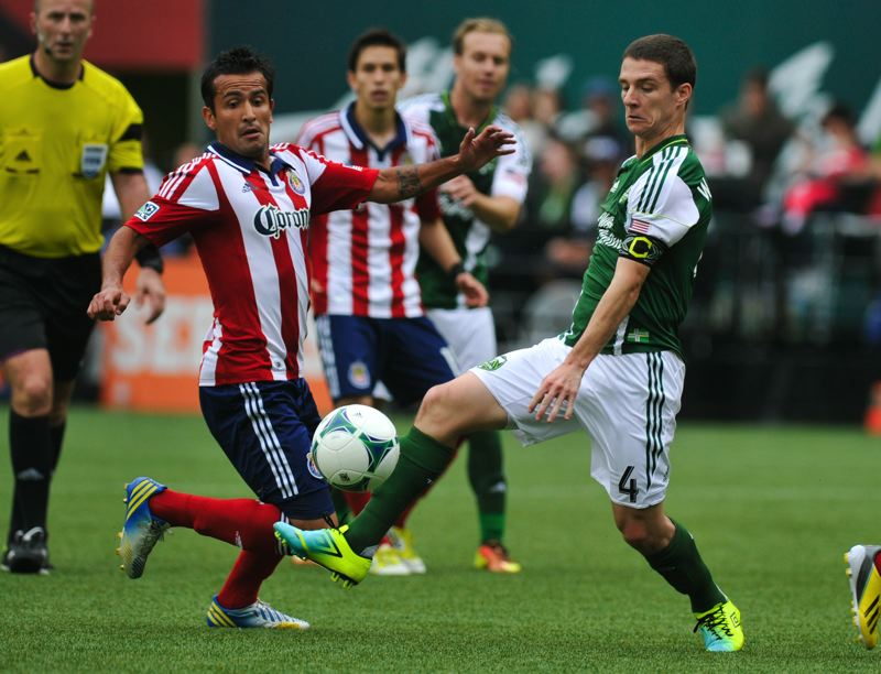 by: COURTESY OF JOHN LARIVIERE - Portland Timbers midfielder Will Johnson (right) battles Chivas USA for possession during an MLS game in May 2013.