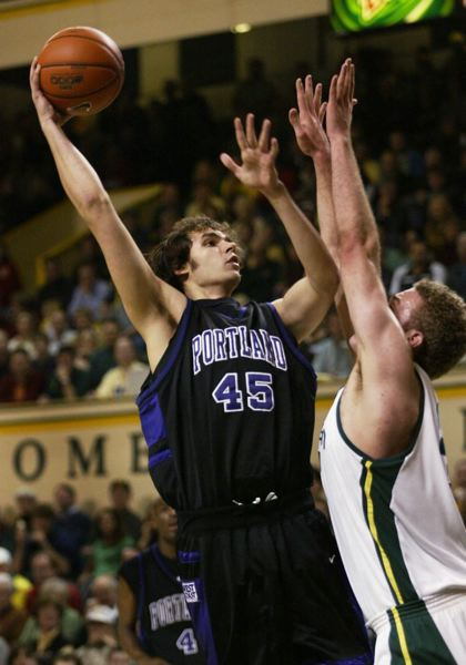 by: TRIBUNE FILE PHOTO: JIM CLARK - Ben Sullivan (left), in a 2004 game against Oregon, shoots for the Portland Pilots and over the defense of the Ducks' Mitch Platt.