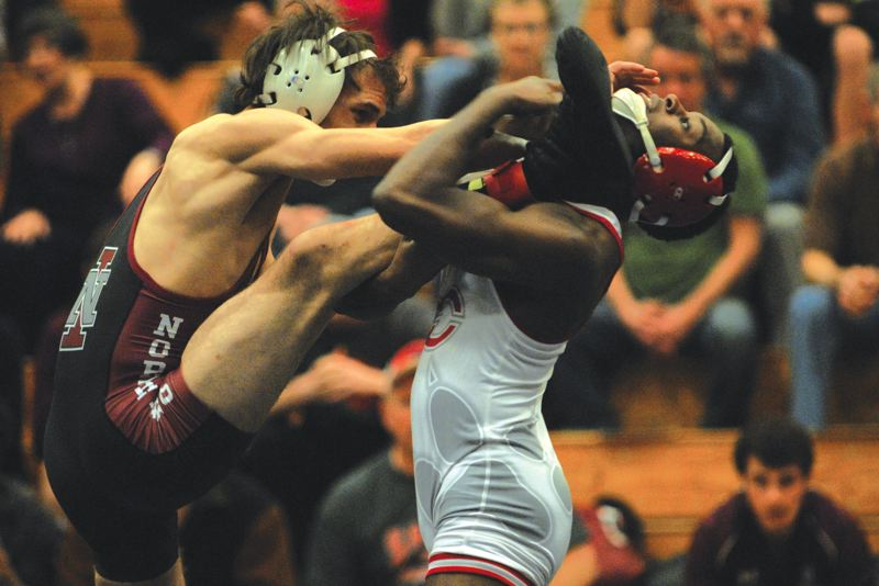 by: PAMPLIN MEDIA GROUP: DAVID BALL - Clackamas CC sophomore C.J. Palmer works to take North Idahos Zach Mahaney off his feet at 133 pounds on Saturday. Palmer won by fall late in the first round.