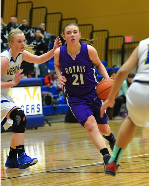 by: COURTESY OF BETH MUMFORD - Guard Demi Guild looks to penetrate on the dribble against Vernonia.