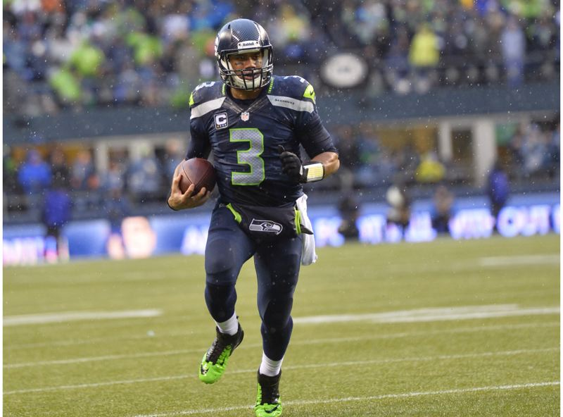 by: COURTESY OF MICHAEL WORKMAN - Quarterback Russell Wilson and the Seattle Seahawks won the NFC title 23-17 Sunday against the San Francisco 49ers.