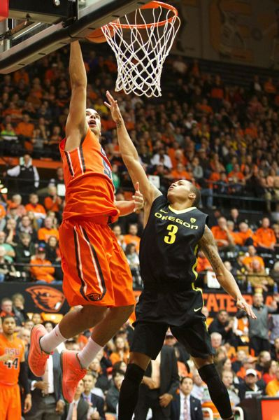 Oregon State's Roberto Nelson goes up against Oregon's Joseph Young.