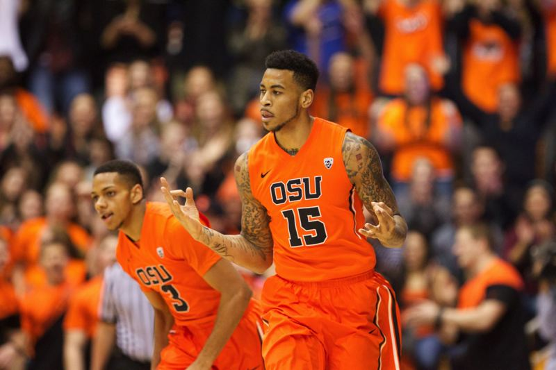 Eric Moreland of Oregon State signals his 3-point basket.