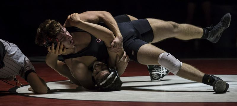 by: JON HOUSE - Oregon City senior Wyatt Griffith won by 15-4 major decision over West Linn junior Will Alvarado at 152.