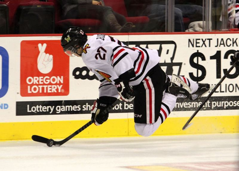by: TRIBUNE PHOTO: JONATHAN HOUSE - Oliver Bjorkstrand, Portland Winterhawks forward, goes airborne during Monday night's home victory against the Vancouver Giants.