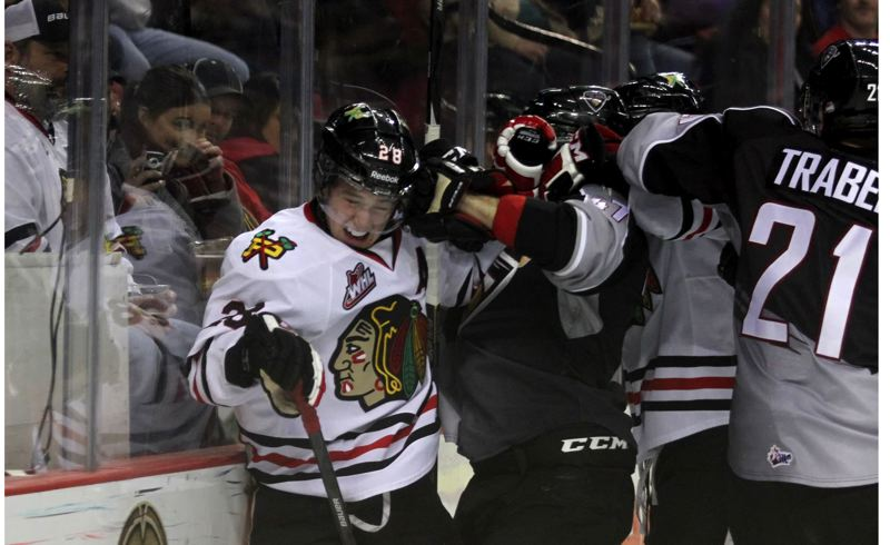 Winterhawks forward Brendan Leipsic (left) gets in a tussle during Monday's Western Hockey League victory at home against Vancouver.