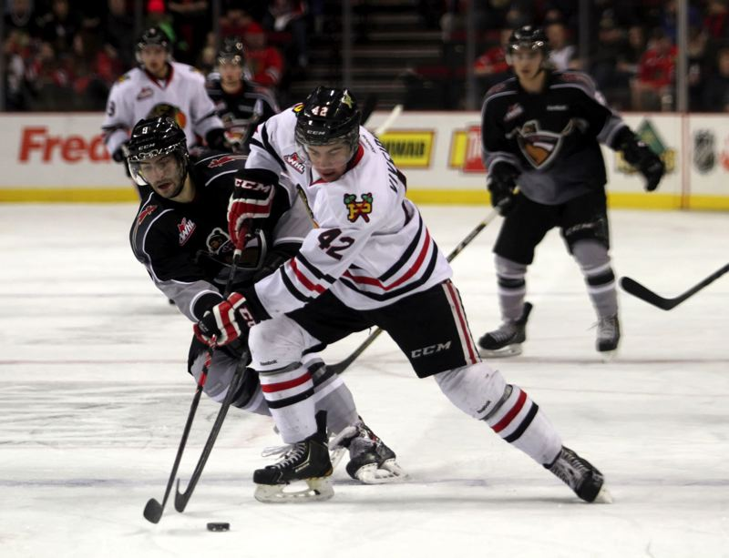 The Winterhawks' Layne Viveiros goes for the puck against the Vancouver Giants.