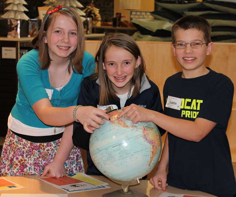 by: SPOKESMAN PHOTO: KATE HOOTS - Semifinalists battled through three tie-breaker rounds at Inza R. Wood Middle Schools geography bee Jan. 14. From left, Katie Walter, Ally Finkbeiner and Justin Carpenter all competed.