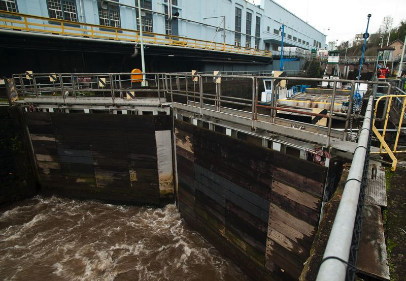 by: SPOKESMAN FILE PHOTO: JOSH KULLA - Willamette Falls Locks, shown here during a temporary opening a year ago to allow the Canby Ferry to travel downstream, is the subject of an economic analysis study backed by the city of Wilsonville and Wilsonville Concrete.