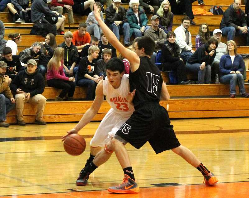 by: CORY MIMMS - Cody Partlow pressing into the paint.