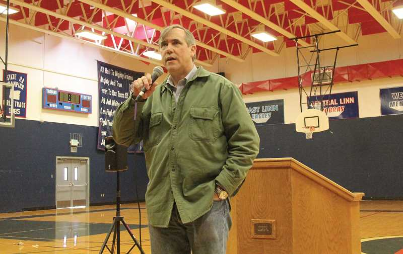 by: MAYGAN BECKERS - U.S. Sen. Jeff Merkley speaks to a crowd gathered at Kennedy High School in Mount Angel Tuesday for a town hall meeting.