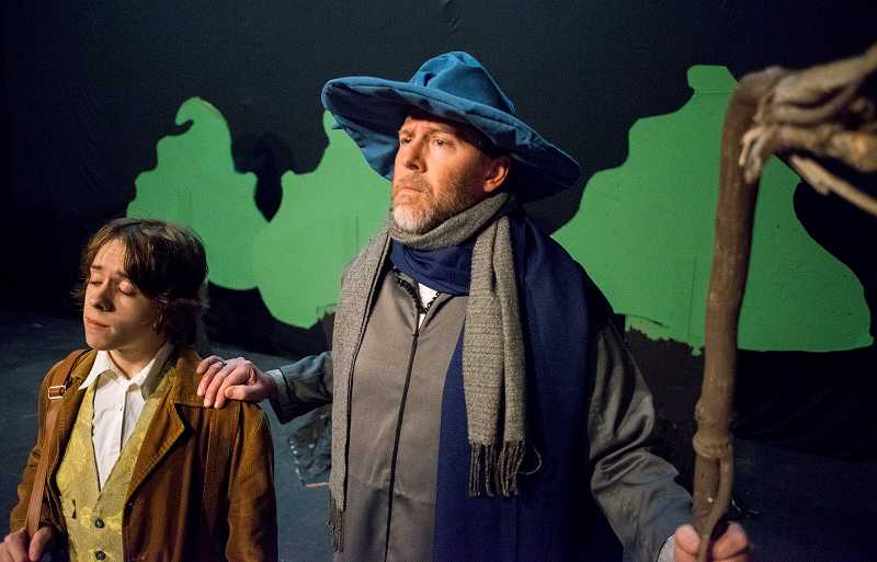 by: NEWS-TIMES PHOTO: CHASE ALLGOOD - Mark Putnam plays Gandalf in Theatre in the Groves production of The Hobbit, which feels like a cozy fireside tale.