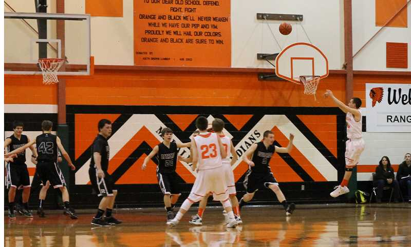 by: CORY MIMMS - Tyler Gengler shoots for three.