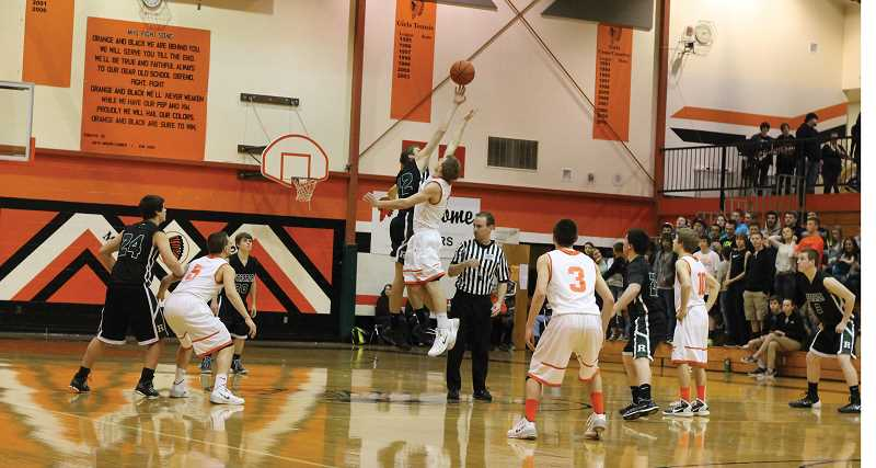 by: CORY MIMMS - Estacada took possession on the tipoff, and the Rangers went on to outplay Molalla in the first half. The Indians turned the tables in the second half though.