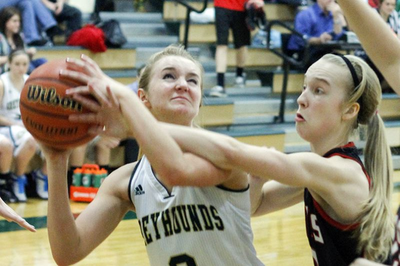 by: NEWS-TIMES PHOTO: CHASE ALLGOOD - Greyhounds junior Haylie Davis draws some contact down low during Gaston's 39-33 loss to Neah-Kah-Nie on Friday.