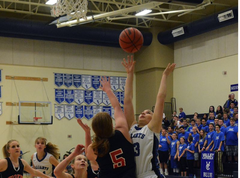 by: TIMES PHOTO: MATT SINGLEDECKER - Valley Catholic post Maddie Vinson floats a layup past a Clatskanie defender for two during the Valiants rout on Friday in Lewis and Clark League action.