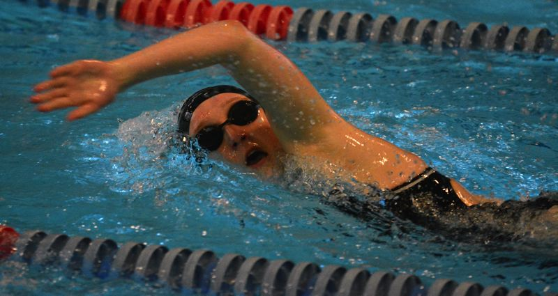 by: TIMES PHOTO: MATT SINGLEDECKER - Beaverton girls senior swim captain Kaitlyn Wright took second in the 100 free and helped both Beaver relays take second against Lincoln.