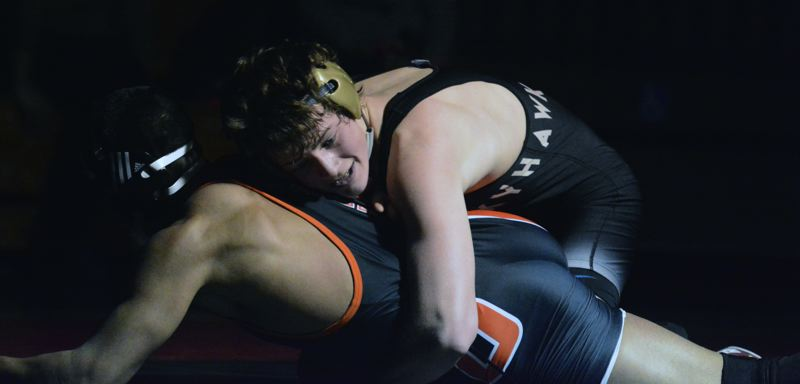 by: TIMES PHOTO: MATT SINGLEDECKER - Southridge 126-pound wrestler Jack Chimenti beat Daniel Diaz by decision for the Skyhawks who took out Beaverton, 59-9, on Thursday.