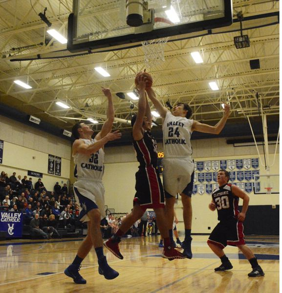by: TIMES PHOTO: MATT SINGLEDECKER - Valley Catholic post Janek Falkenstein goes up for an offensive rebound in the second quarter of the Valiants' win over Clatskanie on Friday.