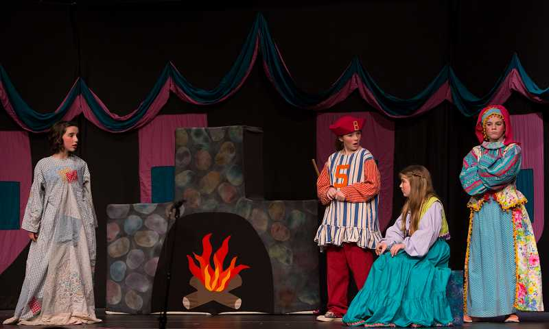 by: SUBMITTED PHOTO: LIONEL COLEMAN - Cinderella, far left, played by Sophie Borah, faces off against her cruel stepmother and stepsisters. From left: Lily Brix, Ella Hardie and Ali Hoevet.