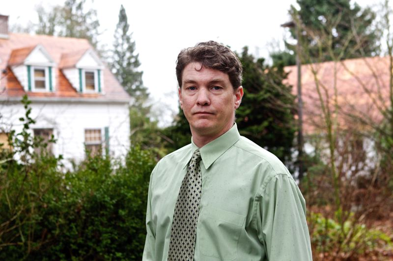 by: PAMPLIN MEDIA GROUP PHOTO: JAIME VALDEZ - Attorney Nick Merrill stands outside a large home in Southwest Portland that a developer wants to replace with three smaller ones.
